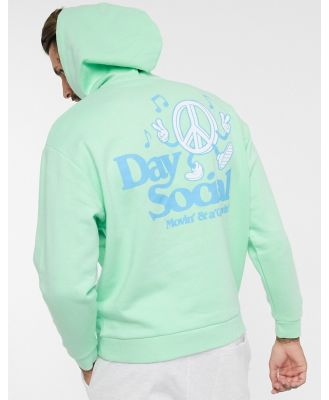 ASOS Daysocial oversized hoodie with hood insert detail and logo in green