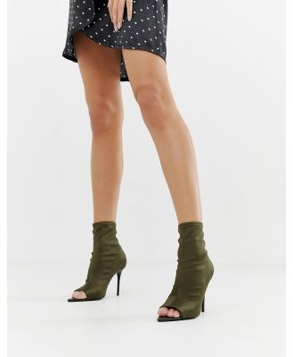 ASOS DESIGN Esther stiletto open toe sock boots in khaki-Green