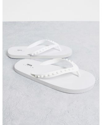 ASOS DESIGN flip flops with rubber studs in white