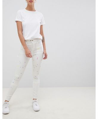 ASOS DESIGN high-rise ridley 'skinny' jeans with painter styling in pax painted wash-White