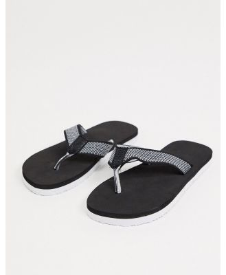 ASOS DESIGN knitted thongs in black and white