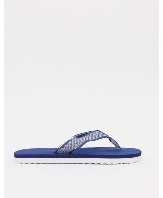 ASOS DESIGN knitted thongs in navy and white