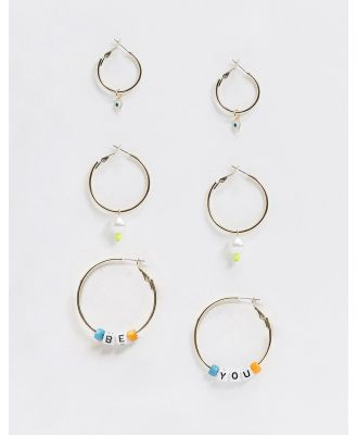 ASOS DESIGN pack of 3 hoop earrings with faux pearl and letter bead charms BE YOU in gold tone