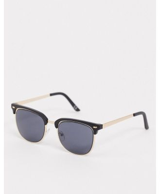 ASOS DESIGN retro sunglasses in gold with black brow detail and solid black lens