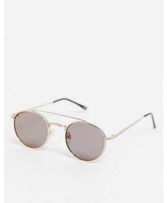 ASOS DESIGN round sunglasses in gold with brow bar and smoke lens-Silver