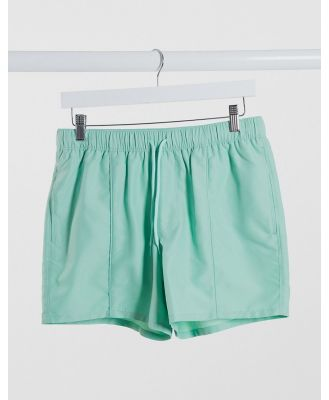 ASOS DESIGN swim shorts in green with pin tuck in short length