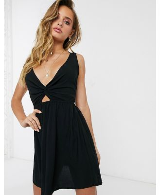 ASOS DESIGN tie back beach sundress with twist front detail in black