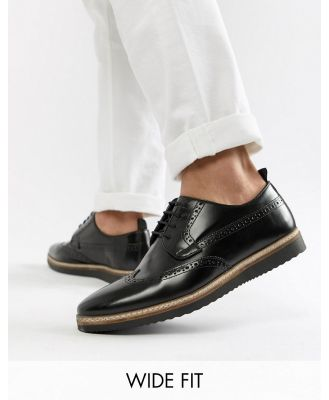 ASOS DESIGN Wide fit brogue shoes in black leather with wedge sole