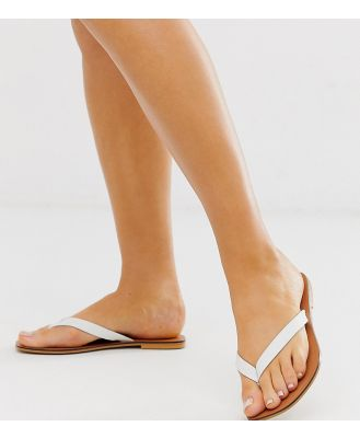 ASOS DESIGN Wide Fit Florence leather flip flop sandals in white