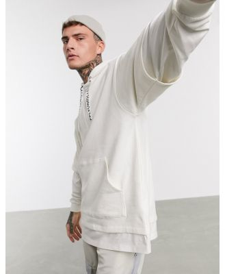 ASOS Unrvlld Supply oversized double layer hoodie in beige with drawcord taping detail