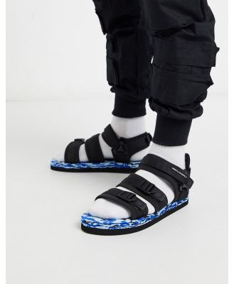 ASOS Unrvlld Supply tech sandals in black with colour pop sole