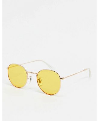 A.Kjaerbede round sunglasses in gold with yellow lens