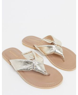 Accessorize leather knotted thongs in rose gold