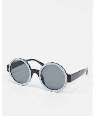 AJ Morgan round sunglasses in black with white lens detailing