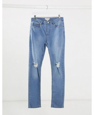 Another Influence skinny NOA jeans in medium blue with knee rip