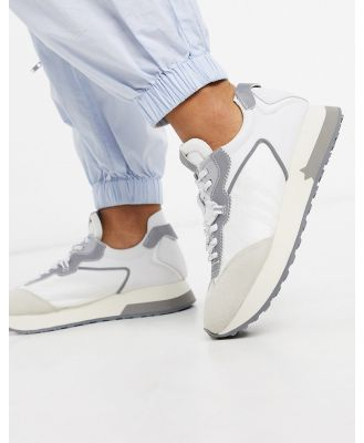 Ash Tiger runner sneakers in white and grey