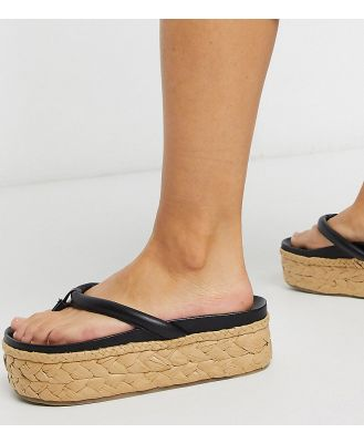 ASRA Exclusive Ember flatform espadrilles in raffia and black leather