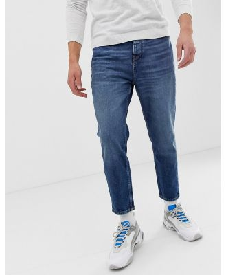 Bershka slim fit jeans in mid blue with cropped leg