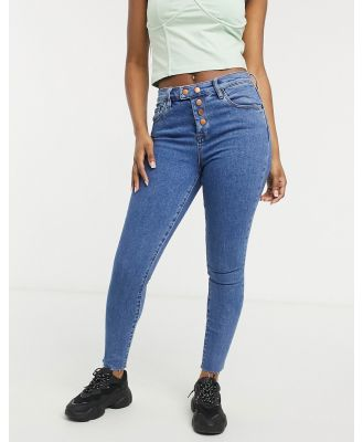 Blank NYC exposed button front skinny jeans in mid varsity blue
