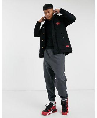 Caterpillar longline workwear jacket in black
