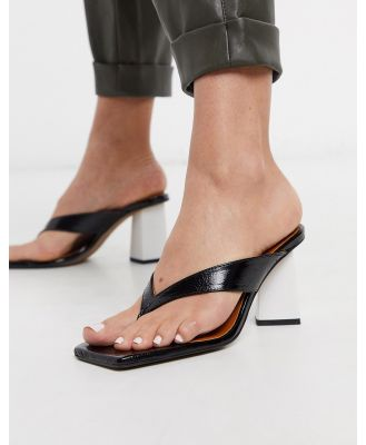 Chio mules with toe post in black leather