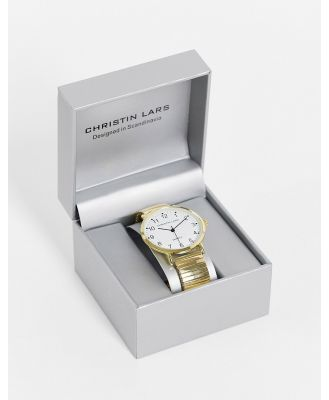 Christin Lars gold watch with white dial