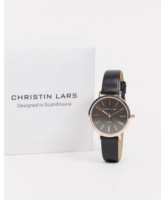 Christin Lars watch with black leather strap and gold dial