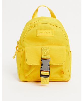Consigned nano clip backpack in yellow
