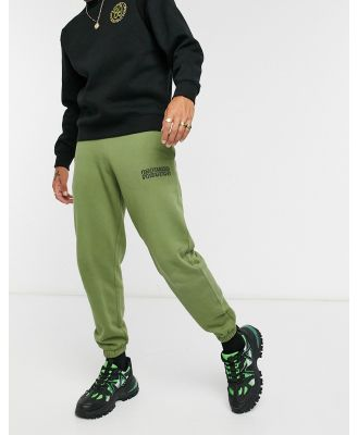 Crooked Tongues trackies in khaki with logo print-Green