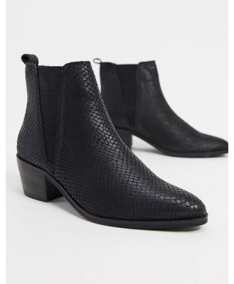 Dune pride elastic gusset ankle boots in black leather
