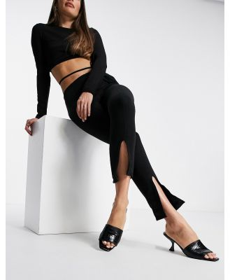 Fashionkilla fitted trackies with split in black