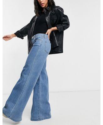 J Brand Evytte 70s mid-rise wide-legged jeans in mid wash blue-White