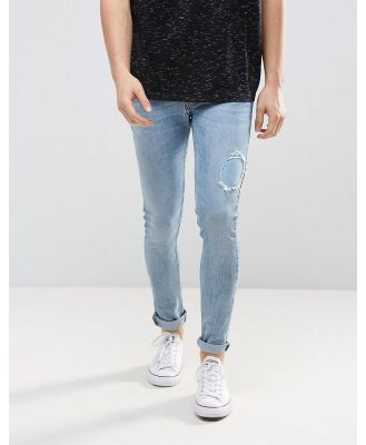 Just Junkies Super Skinny Jeans In Light Wash With Abrasions - Blue
