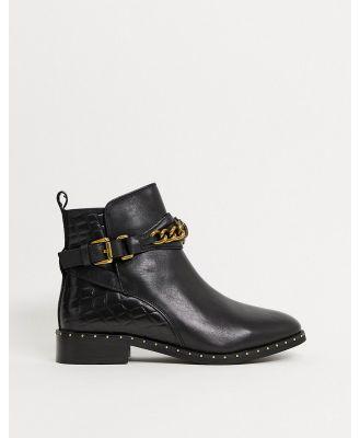Kurt Geiger London Jodhpur eagle chain flat ankle boots in black