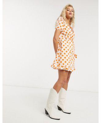 Lost Ink wrap front smock mini dress in tonal polka dot-Pink